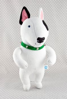 Bull Terrier in a green collar with studs, soft art toy
