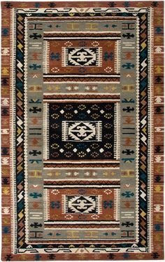 The Rizzy Southwest SU2592 area rug is a reproduction of Native American art and textiles. This entire collection introduces the tribal/ lodge theme to any dwelling or lake home. Each rug is hand- tufted in India of 100% wool, and available in 13 sizes including 6' and 8' rounds, 4 sizes of runners, an extra large 10' x 13', and even custom sizes. http://www.ruggoddess.com/rizzy-southwest-su2592-brown-multi-area-rug.html
