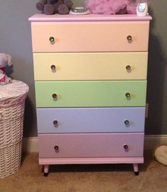 Granny's dresser redone for Arya.  Pastel rainbow dresser. Girls dresser. Antique dresser makeover.