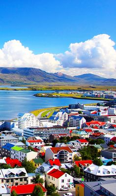 The bright colors of Reykjavik, Iceland, shines even brighter in the summer sun. The charming city is located by the sea, with the mountain Esja overlooking it. In bright summer weather with clear blue skies you can even see all the way to Snæfellsnes National Park and the glacier Snæfellsjökull.