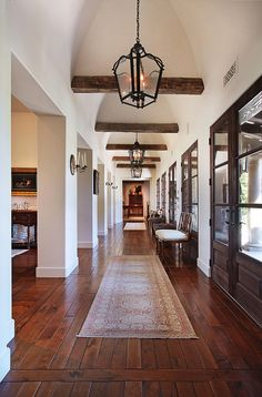 dark ceiling beams against white walls, doors, floors