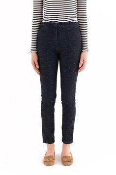 Jeans in denim scuro con pois bianchi