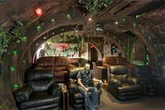 so it isn't a castle, but I love this movie room. I want to do something similar, but make it seem like the inside of a steampunk airship.