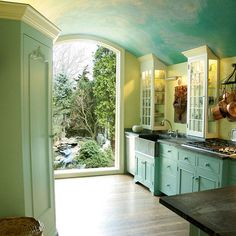 Beautiful sky blue kitchen + painted cabinets + soft green walls  My favorite kitchen ever!
