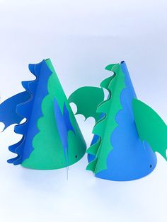 Dragon birthday party hat. Can be used for parties or costume/dress up play. Comes in green or blue but colors can be customized for your event. Size: 6.5 inches Can be purchased as a single hat or in party sets. You can also buy one for the special party girl/boy and some of our