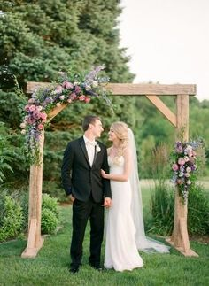 Wooden wedding ceremony arch with pink and purple flowers {Leah Barry Photography} wedding arch Leah Barry Photography - Photography - Cincinnati, OH - WeddingWire Simple Wedding Arch, Wedding Arch Flowers, Wedding Arch Rustic, Wedding Ceremony Arch, Wedding Altars, Wedding Ceremony Decorations, Floral Wedding, Church Decorations, Reception