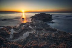 jmbillings posted a photo:  Long exposure sunrise shot over the waters of the mediterranean,taken from the beach at Punta Prima