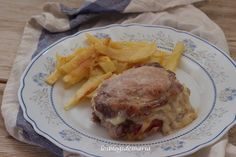 Lomo con queso, pimientos rojos  y jamón al horno