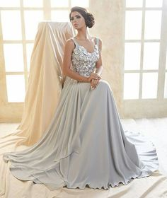 "Kristina Fidelskaya of Dubai has released a capsule collection entitled ""Noor"" for the upcoming Eid celebrations. The 16-piece offering features gowns and mid-length dresses in colours of soft cream, ivory, champagne, shimmery baby blue and gradients of grey, with the use of delicate silks, charmeuse and georgette fabrics, alongside embellished details of floral appliques and lace accents. More: http://senat.us/1sGlnJ0"