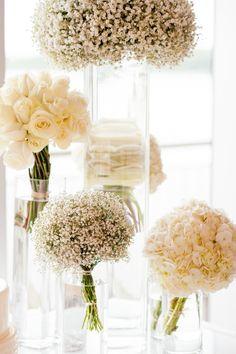 White flowers in glass vases.