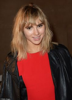 Shaggy chic: The model's hair was style to messy perfection and she wore a flick of eyeliner on each eyelid