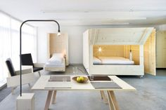 Wooden boxes on wheels fold open to reveal beds inside this minimal apartment in Bolzano, Italy, by Harry Thaler Studio (+ slideshow). Small Space Living, Small Spaces, Living Spaces, Living Room, Studio Living, Living Area, Studio Apartment Bed, Studio Apartments, Cama Murphy