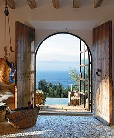 Lovely door to the backyard from the wine cellar, perhaps. | 23 Grandiose and Big Front Doors