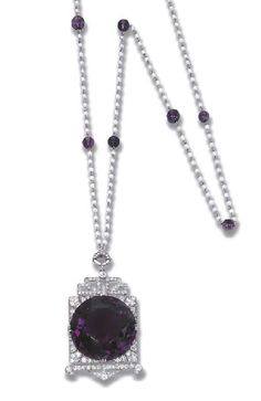 A RARE ART DECO AMETHYST AND DIAMOND SAUTOIR, BY FOUQUET – Christie's The central circular-cut amethyst within a diamond surround of stylised oriental motif to the pearl and amethyst bead sautoir, circa 1925, 83.0 cm. long Signed G Fouquet for George Fouquet (2)