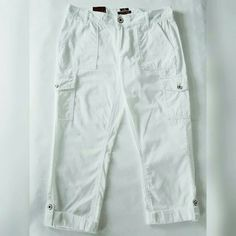 Last CallTommy Hilfiger Cropped Cargo Pants Low rise: approx. 8-1/2 inches Slim fit through hips and thighs Straight leg is cropped Zipper and button closure Belt loops Utility pockets at front; flap pockets at back and at outer legs Cuffed; can be uncuffed Approximate inseam: 26 inches Cotton Machine washable Tommy Hilfiger Pants