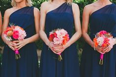 navy dresses with pink and orange flowers (fall wedding)
