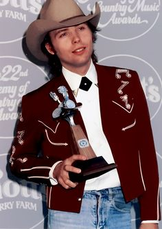 Dwight Yoakam with Academy of Country Music Award for Top New Male Vocalist (1987)