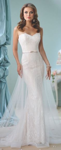 This strapless sweetheart tulle and lace slim A-line cage gown features a natural waist belt with center bow, a chapel length train and removable straps.