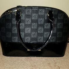 Black Bag Beautiful black dome shape with gray lion print. It is glossy and matte black bag with adjustable shoulder strap. Inside is purple silky lining with one zipper pocket and two pockets. Never used. Gorgeous bag. It says Anne Klein as the designer of the bag. It stands on it own so no worries about it falling over Anne Klein Bags Satchels