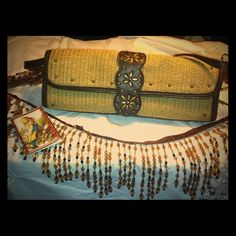 Mizrahi for target Beachcomber purse Gently previously owned. In great shape! I used this 2 times for a dinner date, but its too small for my needs. The handle detaches, converts  into a clutch bag. Great for the spring. Isaac mizarhi  Bags