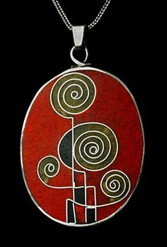 I used to own a pendant by Bauhaus artist Kathe Ruckenbrod, very like this one. Designed in the 1940s,my pendant was in shades of pink and brown...I sold it one day many years back when I needed some money ...but i wish i hadn't !!