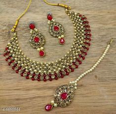 Jewellery Set Trendy Alloy Jewellery Set Base Metal: Alloy Plating: Gold Plated Stone Type: Pearls Sizing: Non-Adjustable Type: Necklace Earrings Maangtika Multipack: 1 Country of Origin: India Sizes Available: Free Size   Catalog Rating: ★4.2 (598)  Catalog Name: Diva Colorful Jewellery Sets CatalogID_1060010 C77-SC1093 Code: 923-6650944-408