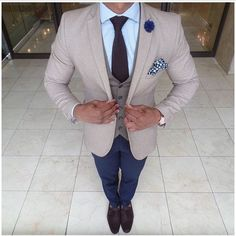 A beige suit jacket and navy casual pants are a great outfit formula to have in your arsenal. Turn your sartorial beast mode on and throw in a pair of dark brown leather tassel loafers.   Shop this look on Lookastic: https://lookastic.com/men/looks/blazer-waistcoat-dress-shirt/24063   — Light Blue Dress Shirt  — Navy Lapel Pin  — Dark Brown Knit Tie  — White and Navy Gingham Pocket Square  — Grey Waistcoat  — Beige Blazer  — Navy Chinos  — Dark Brown Leather Tassel Loafers
