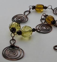 Green glass necklace with handmade copper spirals. £20.00