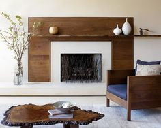 surround fireplace with white and then wood, but higher on wall