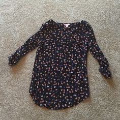Floral top BRAND NEW!!! Very cute - sheer and flowy. 3/4 sleeve and 2 pocket details on front Candie's Tops Blouses