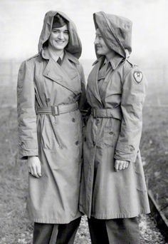 Flying nurses of the USAAF Ninth Troop Carrier Command, wearing special mac coats (Trench Coats) with hoods in case of wet weather at their base in England during the Second World War March 1944 ~