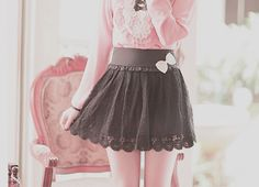 A cute ensemble of the black eyelet skirt with the pink button up blouse.