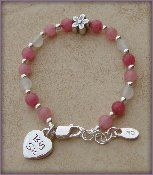 "Big Sis - Flower Sterling Silver Childrens Girls Bracelet Childrens Big Sister pink and white jade w/ whimsical daisy flower, ""Big Sis"" heart charm Size Large 6-13 Years Hail Mary Gifts. $45.00. Made in America"