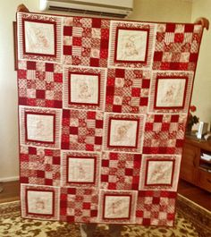 Patchwork quilt - Sun Bonnet Sue red and white redwork single bed quilt.  Each embroidery block has a different design of Sun Bonnet Sue.  Made and designed by Steph Hateley