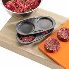 """Nonstick hamburger slider mold for 3-ounce patties.   Product: Double burger slider moldConstruction Material: AluminumColor: Gray  Features: Divots on both halves of the mold will press your patty into the perfect shape  Convenient nonstick coating makes for easy cleanup     Makes a perfect 3 ounce pattyGives you a more evenly cooked slider and reduces burger bulge    Dimensions: 1.75"""" H x  9.25"""" W x 4.5"""" D"""