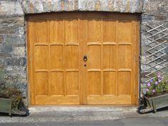 Bespoke wooden Garage Doors in Oak.