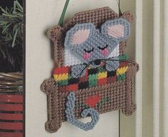 Christmas Ornaments Plastic Canvas Patterns mouse, via Etsy.
