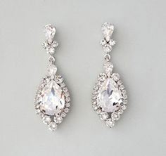 "Levina Earrings designed by Ambrosia Bridal©  Crystal Bridal Earrings in vintage style. Chandelier drop earrings in  rhodium silver with genuine Swarovski crystals in a beautiful teardrop  shape.  Earrings are 2 3/16"" in length and 1 1/4"" at the widest part."