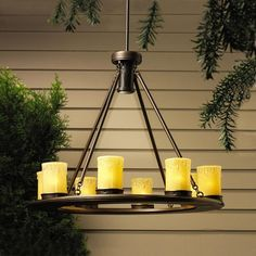 Kichler Lighting 15402OZ 9 Light Trail Chandelier Outdoor by Kichler. $882.00. Finish:Olde Bronze, Light Bulb:(9)6.5w T3 Wedge Xenon  This attractive chandelier is outdoor-ready with its rugged lodge design wth candle-style lights to illuminatea pergola, gazebo, open outdoor kitchen or dining area. Brass construction with beige glass candle with clear top and candle-drip trim.   Extension stems included  Canopy assembly, 25 feet of #12-2 SPT cable  42' of usable #16-2, ...