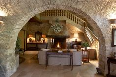 Converted 15th century stone-built mill house in the South of France - Mouans Sartoux.  Those stone walls and that arch.  Swoon.