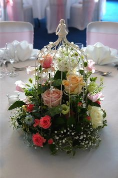 Stunning centerpiece made with Pearl Avalanche and Sweet Avalanche by Meijer Roses, designed by Green Room Flowers