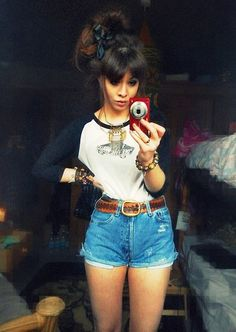 Black Silk Bow, Topshop Collar Ethnic Necklace, Various Bracelets, Vintage Tooled Leather Belt, Levi Vintage Cut Off High Waisted Frayed Shorts, Vans Of The Wall Baseball Tee