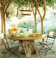 ...a concrete table with a tree-stump base