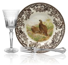 Spode Woodland pattern dates from 1828 and all of its variations since has become one of the most popular table settings for the holiday season. Finely detailed depictions of woodland inhabitants features illustrations of fish,game animals, birds, and hunting dogs in their natural habitat surrounded by a brown & white flower design.Today dishwasher & microwave safe & made in Asia.The borders on all  Woodland patterns are identical.  The Delamere has the border only.  Made to mix and match.