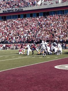The University of Montana Grizzlies in mid action of an extra point play. Go Griz!