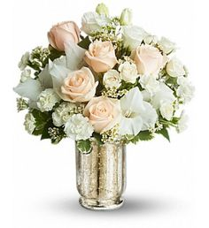 Turn on the charm with this elegant white and crème bouquet. Delivered in a classic Mercury Glass Vase, the delicate arrangement is as romantic as they come.