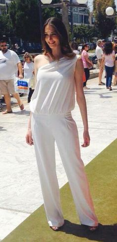 A white jumpsuit goes always with a smile