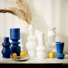 """Totem Vases #westelm. In white, interesting shapes, maybe a small grouping. 8-inch: 4.3""""diam. x 7.6""""h. 10.5-inch: 4.8""""diam. x 9.8""""h. 12.5-inch: 5.3""""diam. x 11.7""""h. 14-inch: 5.3""""diam. x 14.1""""h. 15-inch: 6.1""""diam. x 14.4""""h. 16.5-inch: 6.3""""diam. x 16""""h."""