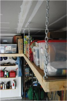 Suspended overhead garage shelves http://garagestorageideas.net/how-to-improve-the-shelving-system-in-your-garage/