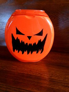 Used a black marker to make a jack o' lantern out of a Tides pods container